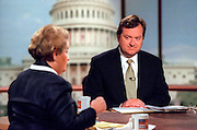 Host Tim Russert talks with Secretary of State Madeleine Albright during NBC's Meet the Press August 9, 1998 in Washington, DC.