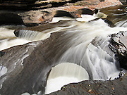 """The Presque Isle River carves round potholes in Nonesuch Shale rock before flowing into Lake Superior. Porcupine Mountains Wilderness State Park, Michigan, USA. Published in """"Light Travel: Photography on the Go"""" by Tom Dempsey 2009, 2010."""