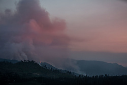 July 26, 2018 - Yosemite National Park, California, U.S - A smoke plume, as seen from Highway 120 in Yosemite National Park, rises from the Ferguson Fire, burning above El Portal, California. Yosemite Valley closed at noon yesterday to all visitors due to poor air quality and safety concerns. Firefighting personnel and equipment are traveling through the park, as well as along adjacent roads due to the Ferguson Fire. (Credit Image: © Tracy Barbutes via ZUMA Wire)