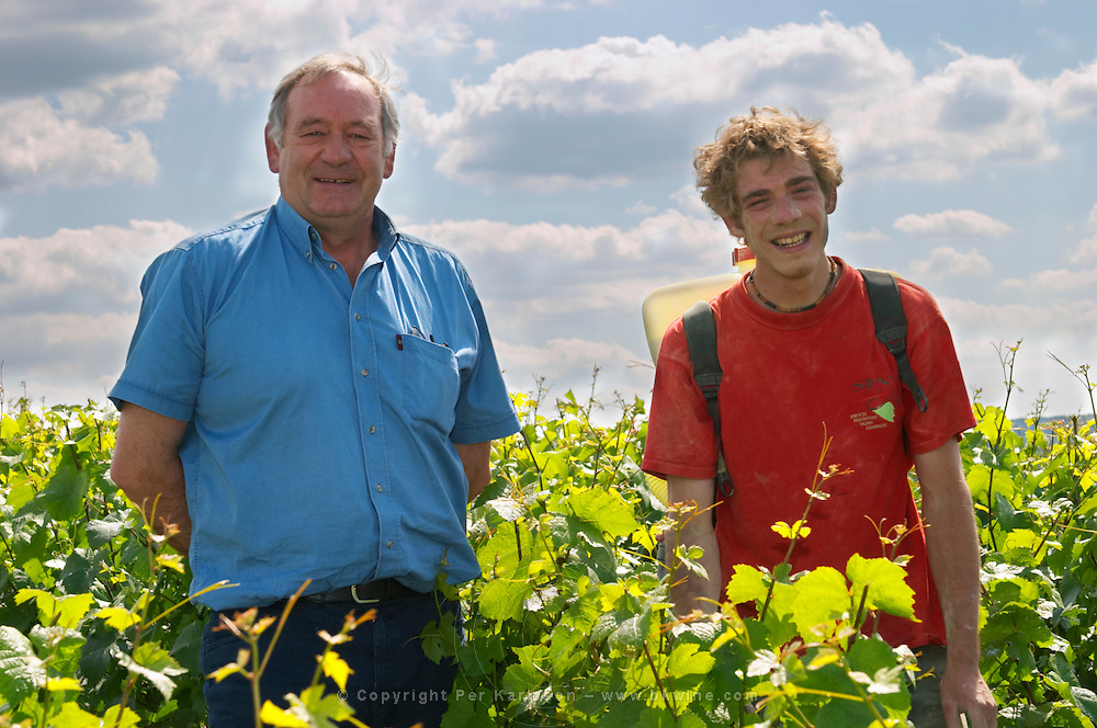 Francois Seconde and his son in the vineyard planted with Pinot Noir Champagne Francois Seconde, Sillery Grand Cru, Montagne de Reims, Champagne, Marne, Ardennes, France