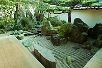 """Daisen-in is a sub-temple of Daitoku-ji of the Rinzai sect of Zen Buddhism, one of the five most important zen temples of Kyoto. The name means """"The Academy of the Great Immortals."""" Daisen-in was founded by the Zen priest Kogaku Soko and was built between 1509 and 1513.  Daisen-in is noted for its karesansui, or zen garden.  The garden was created in the eary 16h century and is attributed to the monk painter Soami. The main garden, is in an L shape.  It contains a miniature landscape similar to a Song Dynasty landscape painting, composed of rocks suggesting mountains and a waterfall, clipped shrubs and trees representing a forest, and raked white gravel representing a river. IMAGE NOT AVAILABLE IN JAPAN"""