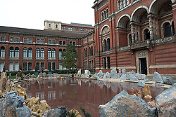 © Licensed to London News Pictures.31/10/2013. London, UK.The installation of the Chinese artist Xu Bing by the lake of he John Madejski Garden at V&A Museum. Travelling to the Wonderland inspired by the classic Chinese fable Tao Hua Yuan (The Peach Blossom Spring). The V&A invited Xu Bing to create a major new work to coincide with the Museum's forthcoming exhibition, Masterpieces of Chinese Painting 700 – 1900.Photo credit : Peter Kollanyi/LNP