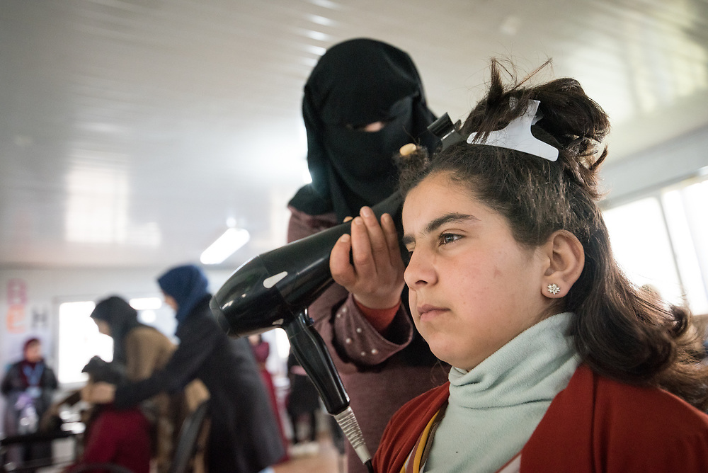 20 February 2020, Za'atari Camp, Jordan: Young girl Abeer Qudah acts as model during hairdressing class in the Peace Oasis, a Lutheran World Federation space in the Za'atari Camp where Syrian refugees are offered a variety of activities on psychosocial support, including counselling, life skills trainings and other activities.