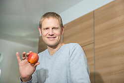 Man holding red apple