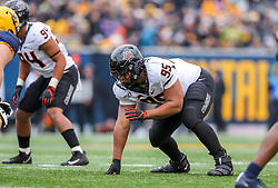 Nov 23, 2019; Morgantown, WV, USA; Oklahoma State Cowboys defensive tackle Israel Antwine (95) lines up before a snap during the third quarter against the West Virginia Mountaineers at Mountaineer Field at Milan Puskar Stadium. Mandatory Credit: Ben Queen-USA TODAY Sports