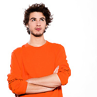 young thinking caucasian man portrait in studio on white background