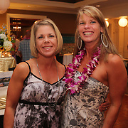 Melissa Hegarty, left, and Cathey Cella pose for a photo Saturday August 2, 2014 during Pipeline to a Cure, a benefit for Cystic Fibrosis at the Country Club of Landfall in Wilmington, N.C. (Jason A. Frizzelle)