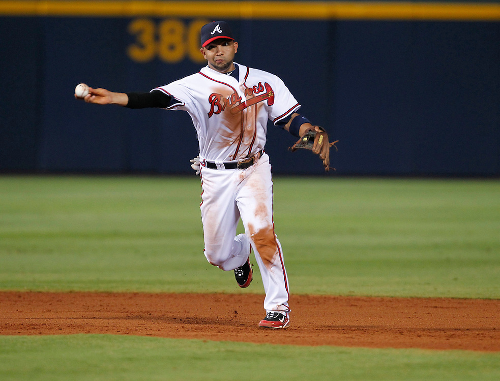 ATLANTA - AUGUST 7:  Shortstop Alex Gonzalez #2 of the Atlanta Braves makes a play on a ground ball during the game against the San Francisco Giants at Turner Field on August 7, 2010 in Atlanta, Georgia.  The Braves beat the Giants 3-0.  (Photo by Mike Zarrilli/Getty Images)