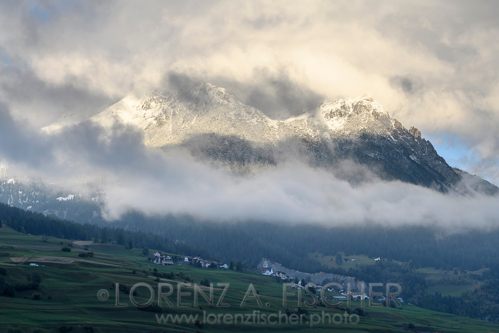 The village Parsonz and the Piz Toissa with the first snow of the year, Savognin, Parc Ela, Grisons, Switzerland