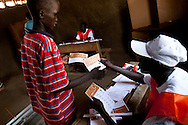 A young boy votes in Sudan first election in decades. Irregularities like children voting were common, in part because they are percieved as men, at a much younger age.