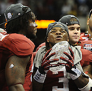 Daily Photo by Gary Cosby Jr.    ..Courtney Upshaw and Trent Richardson celebrate with the crystal football from the Coaches Trophy after Alabama defeated LSU 21-0 to claim their 14th National Championship...................................