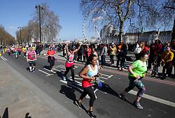 Competitors run past the London Eye during the 2019 London Landmarks Half Marathon.