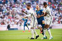 Real Madrid's player Sergio Ramos and Raphael Varane and Celta de Vigo's player John Guidetti during a match of La Liga Santander at Santiago Bernabeu Stadium in Madrid. August 27, Spain. 2016. (ALTERPHOTOS/BorjaB.Hojas)