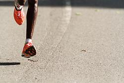 NYRR Oakley Mini 10K for Women: detail of feet on pavement, winner 31:15 Mary Keitany, Kenya, adidas