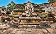 A serene Buddha amongst the ruins of the old city.<br /> (Photo by Matt Considine - Images of Asia Collection)