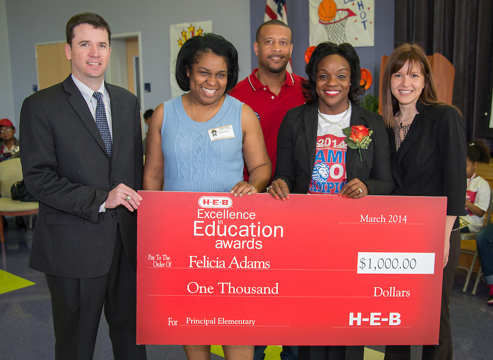 L-R: Houston ISD Chief Schools Officer Andrew Houlihan, Trustee Paula Harris, Ray Adams, Lockhart Elementary School principal Felicia Adams and School Support Officer Karla Loria pose for a photograph after Mrs. Adams was named a finalist in the HEB Excellence in Education Awards, April 4, 2014.