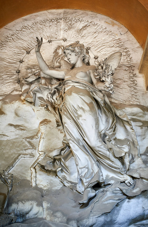 Picture and image of the stone sculpture of an angel over the sarcophagus of Salvatore and Rosa Queirolo, sculpted by G Navone, 1901. Section A, no 16, The monumental tombs of the Staglieno Monumental Cemetery, Genoa, Italy .<br /> <br /> Visit our ITALY PHOTO COLLECTION for more   photos of Italy to download or buy as prints https://funkystock.photoshelter.com/gallery-collection/2b-Pictures-Images-of-Italy-Photos-of-Italian-Historic-Landmark-Sites/C0000qxA2zGFjd_k<br /> If you prefer to buy from our ALAMY PHOTO LIBRARY  Collection visit : https://www.alamy.com/portfolio/paul-williams-funkystock/camposanto-di-staglieno-cemetery-genoa.html