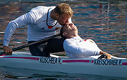 Germany's Kurt Kuschela kisses his team mate Peter Kretschmer (R) in<br /> the forehead after winning their men's canoe double (C2) 1000m finals<br /> A at Eton Dorney at the London 2012 Olympics Games near London, August<br /> 9, 2012.   <br /> REUTERS/Jim Young