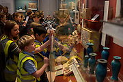 Schoolchildren wearing hi-vis jackets work on projects in the British Museum,on 28th February 2017, in London, England.
