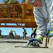 """BATH, Maine -- Repaving and Construction efforts on the Bath Viaduct Overpass are at least a week ahead of schedule according to Peter Brown, State of Maine Project Resident. The originally scheduled date of completion was to be May 23. <br /> """"The driving surface is actually cement,"""" Brown said on Tuesday, May 1.""""We're not going to add additional pavement on top of what's here.""""  While the exact completion date is a function of the next few weeks' weather, the Freeport-based construction crew is nearly completed with finishing the cement surface of the last section of bridge. The cement will take about a week to cure, and lines will have to be painted. Also, because they chose to use cement instead of pavement, the project will come in both ahead of schedule and on budget -- including a speed bonus of $10,000 per day ahead of schedule for the work crew. Photo by Roger S. Duncan."""