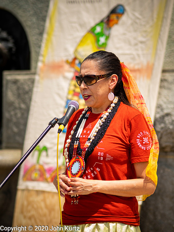 04 JULY 2020 - DES MOINES, IOWA: DONIELLE WANATEE, a member of the Thunder Clan of the Meskwaki Nation, talks about the stereotypical depiction of Native Americans in artwork in Iowa State Capitol. Hundreds of people came to the grounds of the Iowa State Capitol to protest against and in favor of historic monuments on the capitol grounds. Several hundred people protested against a monument to Christopher Columbus and the stereotypical depiction of Native Americans on the capitol grounds. About 50 people came to the capitol to rally in support of the monuments. The protest against the monuments was organized by Seeding Sovereignty, a collective of indigenous women. The rally to defend the monuments was organized by an Iowa chapter of Three Percenters.       PHOTO BY JACK KURTZ