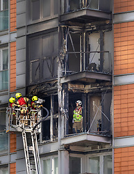 © Licensed to London News Pictures. 07/05/2021. London, UK. Fire fighters is inspect the charred remains of apartments at New Providence Wharf in Poplar in east London. 100 fire fighters and 20 crews tackled the blaze at it's peak. Photo credit: Peter Macdiarmid/LNP