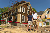 """Patty and Peter Cooke stand in front of the Pickering House on Main Street in Wolfeboro.  The Cooke's are restoring the """"big yellow house"""" built in the 1800's to a 10 room inn with attached barn for weddings and special events.   (Karen Bobotas/for the Laconia Daily Sun)"""