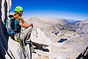 Climber on the northeast ridge of  Bear Creek Spire, John Muir Wilderness, Sierra Nevada Mountains, California
