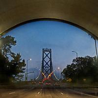 San Francisco's Bay Bridge is framed by a tunnel through Yerba Buena Island in San Francisco Bay, California.