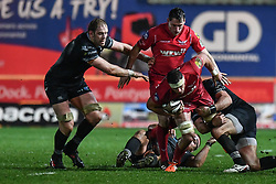 Scarlets' Aaron Shingler is tackled by Ospreys' Olly Cracknell - Mandatory by-line: Craig Thomas/Replay images - 26/12/2017 - RUGBY - Parc y Scarlets - Llanelli, Wales - Scarlets v Ospreys - Guinness Pro 14