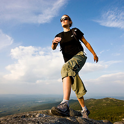 A woman hikes near the summit of Mount Monadnock in Monadnock State Park in Jaffrey, New Hampshire.