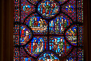 Medieval stained glass Window of the Gothic Cathedral of Chartres, France - dedicated to St Sylvester.  Bottom left - The young Sylvester presented by his mother to the priest Cyrinus, bottom right - Sylvester welcoming St Timothy to his house. Side panel right - above right - Execution of St Timothy , side panel left - Death of the prefect Tarquin, who chokes on a fish bone. Two centre panels, left- Funeral of St Timothy, right - Sylvester refusing the prefect's orders to worship an idol. Top central oval panel - Sylvester released from prison by Pope Melchiades. A UNESCO World Heritage Site.. .<br /> <br /> Visit our MEDIEVAL ART PHOTO COLLECTIONS for more   photos  to download or buy as prints https://funkystock.photoshelter.com/gallery-collection/Medieval-Middle-Ages-Art-Artefacts-Antiquities-Pictures-Images-of/C0000YpKXiAHnG2k