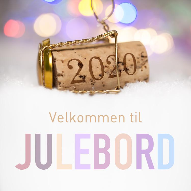 Champagne-kork med innpreget årstall 2020 og tekst «Velkommen til julebord».