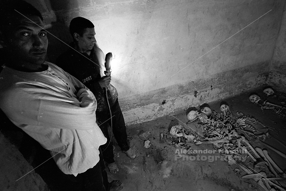 Cairo, Egypt, The City of the Dead, 2000 - Young men show the interior of a crypt they are repairing.