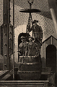 Engineers in leather clothing descending the shaft at Creuzot coal mine to examine the pumps. From  'Underground Life; or, Mines and Miners' by Louis Simonin (London, 1869). Wood engraving.