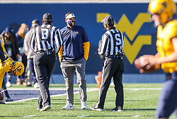 Oct 31, 2020; Morgantown, West Virginia, USA; West Virginia Mountaineers head coach Neal Brown talks to officials before their game against the Kansas State Wildcats at Mountaineer Field at Milan Puskar Stadium. Mandatory Credit: Ben Queen-USA TODAY Sports
