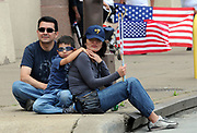 Omar Reyna, his six year old son Joaquin Antonio and his wife Anel wait for the marchers to walk to Dallas City Hall during the MegaMarch for Immigration Reform,  May 01, 2010