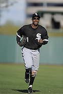 TEMPE, AZ - MARCH 4:  Juan Pierre #1 of the Chicago White Sox runs in from the outfield during the game against the Los Angeles Angels on March 4, 2010 at Tempe Diablo Stadium in Tempe, Arizona. (Photo by Ron Vesely)
