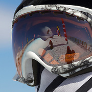 A competitor watches the action, reflected in her goggles, in the Halfpipe Finals during The North Face Freeski Open at Snow Park, Wanaka, New Zealand, 3rd September 2011. Photo Tim Clayton...