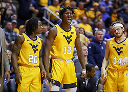 Dec 8, 2018; Morgantown, WV, USA; West Virginia Mountaineers forward Andrew Gordon (12) celebrates from the bench during the first half against the Pittsburgh Panthers at WVU Coliseum. Mandatory Credit: Ben Queen-USA TODAY Sports