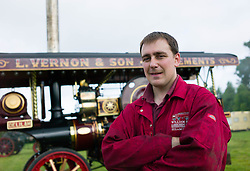 © Licensed to London News Pictures. 01/08/2013<br /> <br /> Pickering, Yorkshire, United Kingdom<br /> <br /> Martin Davidson from Aberdeen stands in front of his steam engine, 'Delilah' at the start of the 61st annual Pickering traction engine rally in North Yorkshire. The event has the largest line up of Showman's engines and fairground organs in the north of England and boasts over a thousand vintage and classic cars, commercials, tractors and motorcycles, arena attractions, a fun fair, steam rollers, steam ploughing and along with food and craft marquees the event is the largest event of it's type in the north of England.<br /> <br /> Photo credit : Ian Forsyth/LNP© Licensed to London News Pictures. 01/08/2013