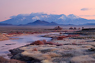 The southern end of the Sangre De Cristo range are viewed at twilight from the Rio Grande river near the state line with Colorado and New Mexico.