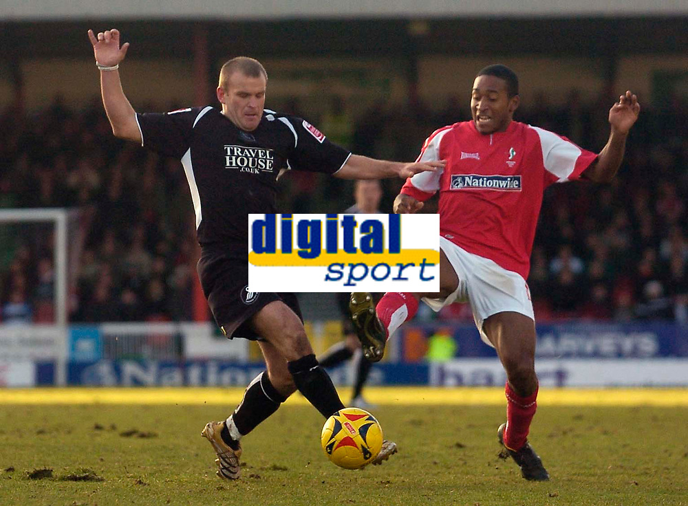 Photo: Alan Crowhurst.<br />Swindon Town v Swansea City. Coca Cola League 1.<br />31/12/2005. <br />Swansea's Andy Robinson (L) and Ricky Shakes go for the ball.