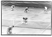 Drying the court after rain before the Pam Schriver/ Steffi Graf Match. U.S Open Tennis Championships Flushing Meadows.© Copyright Photograph by Dafydd Jones 66 Stockwell Park Rd. London SW9 0DA Tel 020 7733 0108 www.dafjones.com