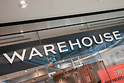Sign for the high street clothing brand Warehouse in Birmingham, United Kingdom.
