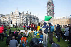 London, UK. 15th April 2019. Climate campaigners from Extinction Rebellion hold an assembly in Parliament Square during the first day of 'International Rebellion UK - Shut Down London!' events to call on the Government to take urgent action to address climate change.