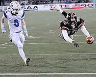 Glenville quarterback Cardale Jones, right, dives into the end zone for a Tarblooder touchdown as the Wildcats' David Carraher trails the play.  (Photo by David Richard/Ohiosportshooters.com)