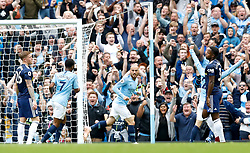 Manchester City's David Silva (centre) celebrates scoring his side's second goal of the game during the Premier League match at the Etihad Stadium, Manchester.
