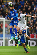 Riyad Mahrez of Leicester wins a header over Daryl Janmaat of Watford.  Premier league match, Leicester City v Watford at the King Power Stadium in Leicester, Leicestershire on Saturday 6th May 2017.<br /> pic by Bradley Collyer, Andrew Orchard sports photography.