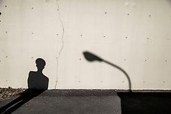 A prison guard's shadow is cast on the walls surrounding Tochigi prison in Tochigi, Japan.